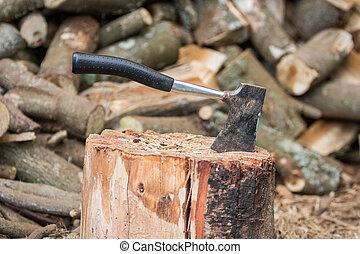 Hatchet in Stump - Hatchet in stump with firewood
