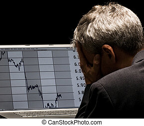 financial crises - desperated man with charts on his laptop