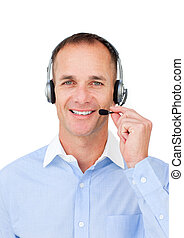 Self-assured mature businessman using headset against a...