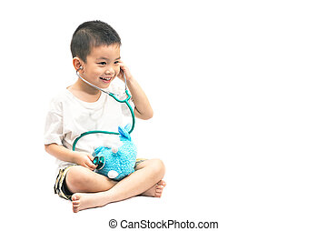 Adorable asian child playing as doctor with bear isolated on white background