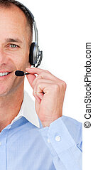 Close-up of a mature Customer service agent talking on...