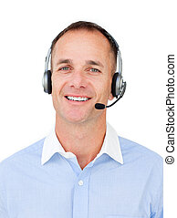 Charming Customer service agent talking on headset against a...