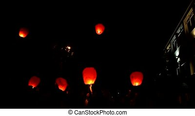 Floating lantern outdoors, in sky