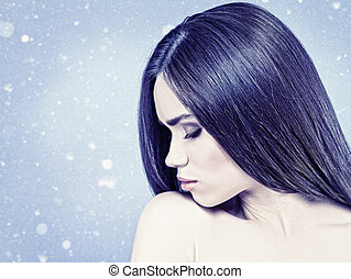 Beauty female portrait over natural winter background