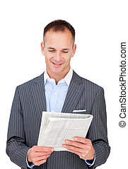 Confident businessman reading a newspaper against a white...