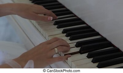 bride's hands playing the piano