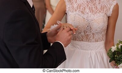 the bride and groom exchange wedding rings