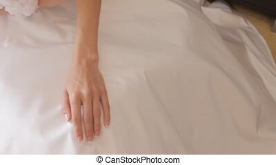Beautiful bride's hands in wedding dress