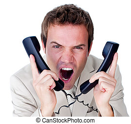 Furious businessman tangle up in phone wires