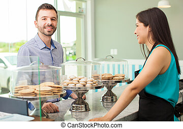 Man buying cookies in a backery