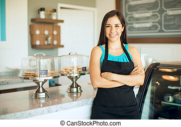 Gorgeous business owner in her shop - Cute Hispanic female...