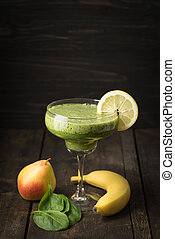 Smoothie in a glass - Healthy green smoothie made of pear,...