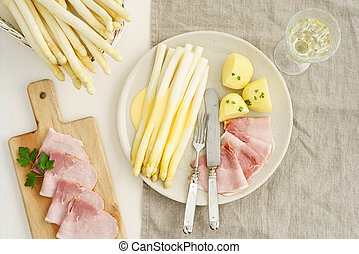 White asparagus with potatoes and boiled ham - White...