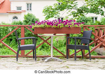 Table and chairs of modern european outdoor cafe