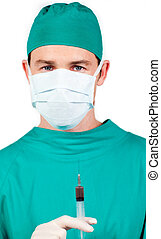 Young surgeon holding a syringe against a white background