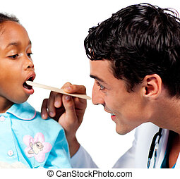 Smiling doctor checking little girl\'s throat isolated on a...