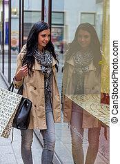 while shopping woman - a young woman at einkausbummel...