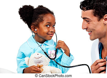 Caring doctor playing with his young patient against a white...