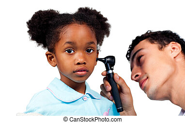 Concentrated doctor examining his young patient