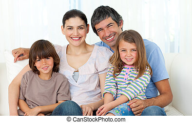 Portrait of a happy family sitting on a sofa