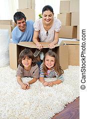 Joyful family packing boxes