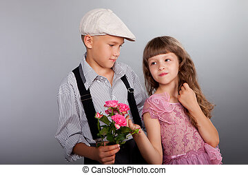 The boy gives a flower to the girl Closeup Photo in retro...