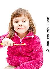 little girl brushing her teeth isolated on white