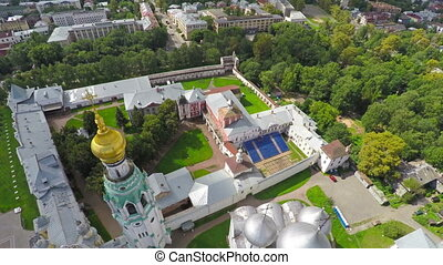 Flying over main square of Vologda city with Kremlin and...