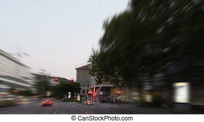 blurred view of a drive through a city - Blurred view of a...
