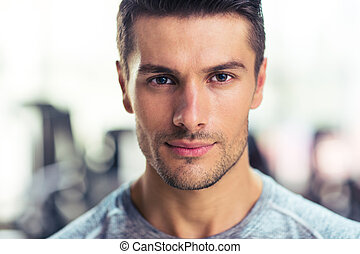 Handsome man at gym - Closeup portrait of a handsome man at...