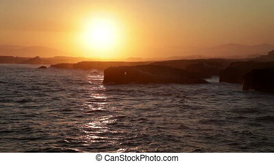 Picturesque sunset over As Catedrais beach in Spain - Scenic...