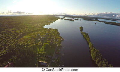 flying over Shuezero lake in Karelia at sunset, Russia