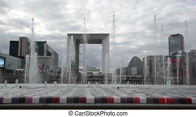 Cloudy view at fountain near La Grande Arche, Paris - Cloudy...