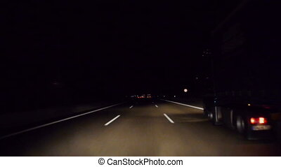 drive on the freeway while a car overtake - Driving by night...