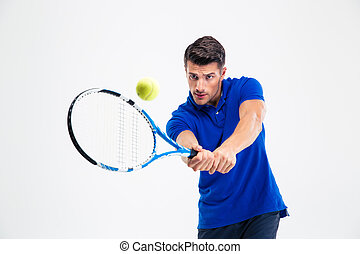 Portrait of a handsome man playing in tennis isolated on a...