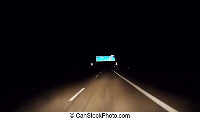 driving along a freeway - Car is driving along a freeway in...