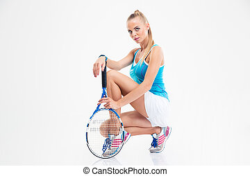 Portrait of a pretty female tennis player isolated on a...