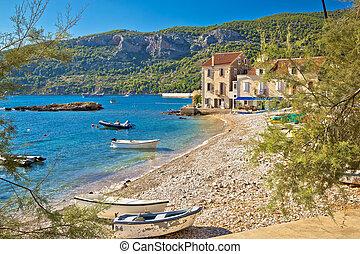 Paradise beach in Komiza adriatic village on Vis island,...