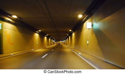 driving fast through a tunnel