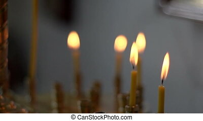Church candles - Some church candles against a dark...