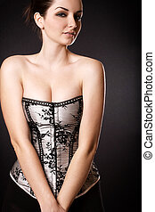 Beautiful woman with cleavage in a corset - A pretty young...