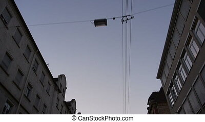 electrical lines and houses during a drive in the city -...