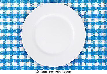 plate on blue checkered tablecloth