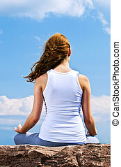 Young girl meditating outdoors - Portrait of young teenage...