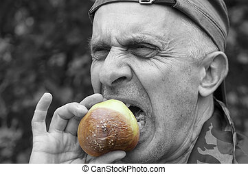Man Eating Disquisting Food - Matured man biting a spoiled...