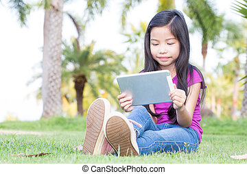 Asian little girl with a Tablet