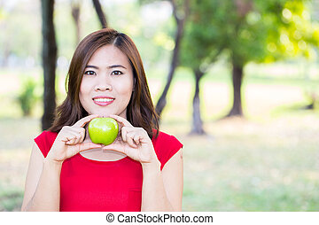 Asian girl show apple with smile face, health food concept, asian woman beauty
