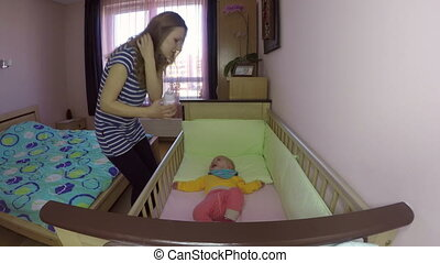 woman feed baby bottle - Tender mother woman feeding her...