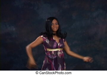 Silly Dance - Attractive African American woman performs a...