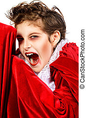 shouting vampire - Expressive teen boy in a costume of...